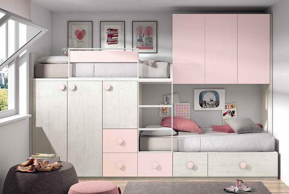 duas camas com guarda roupas e gavetas