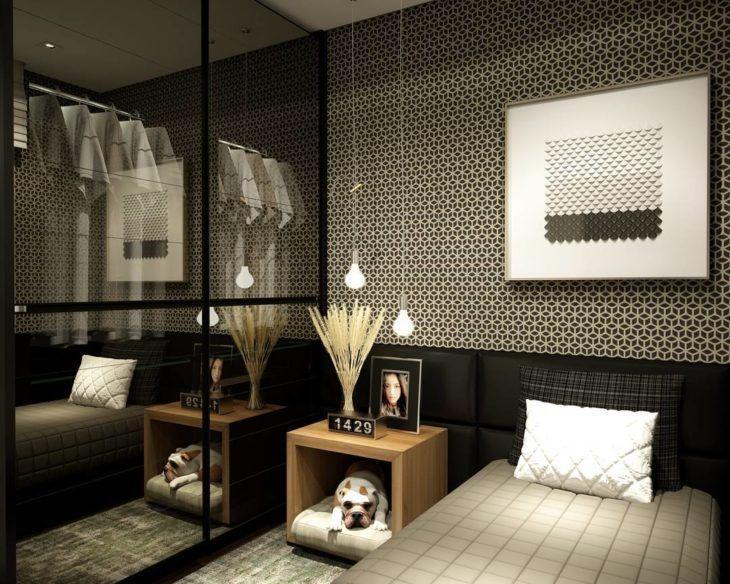 Decoração moderna com papel de parede geométrico e cabeceira de cama preta estofada.