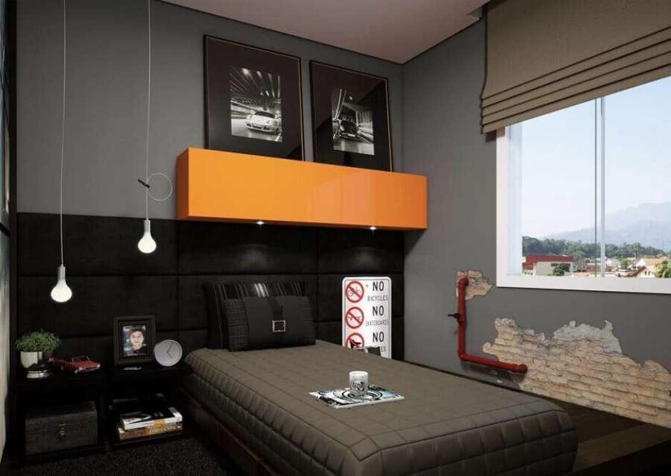 Quarto preto e cinza com decoração moderna e industrial.