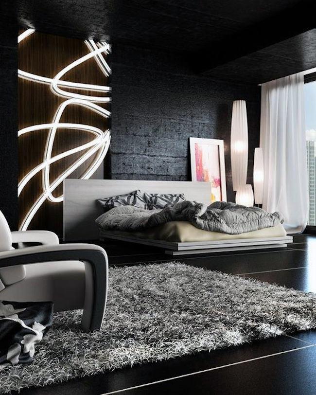 Decoração moderna preto e cinza com painel de madeira.