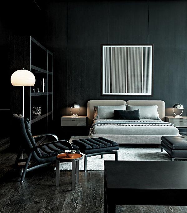 Quarto preto e cinza com decoração moderna e espaço amplo.