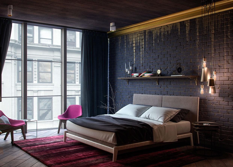 Decoração com parede de tijolinho preto, detalhes em dourado e poltrona rosa.
