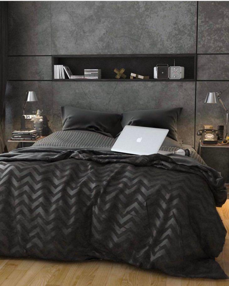 Quarto preto com roupa de cama preta e confortável.