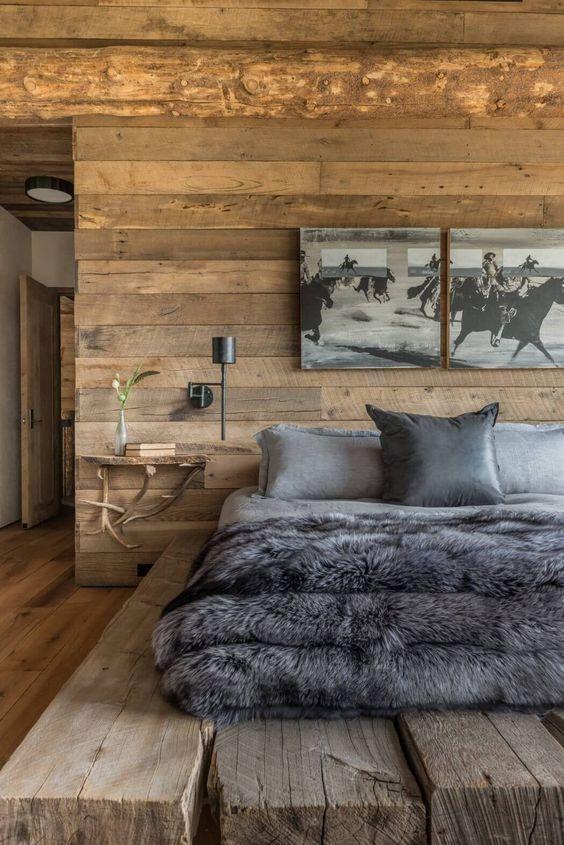 quarto de madeira com cama de vigas
