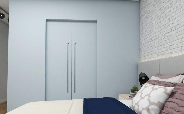Quarto com decoração azul e parede em tijolinho.