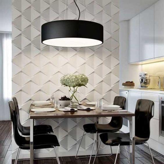 Sala de jantar preta e branca com parede de textura.