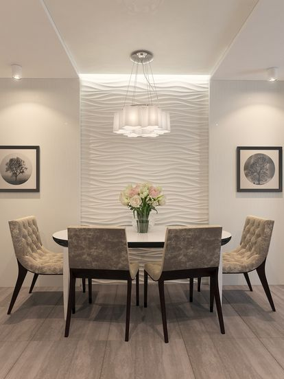 Sala de jantar de cores neutras com parede branca texturizada.