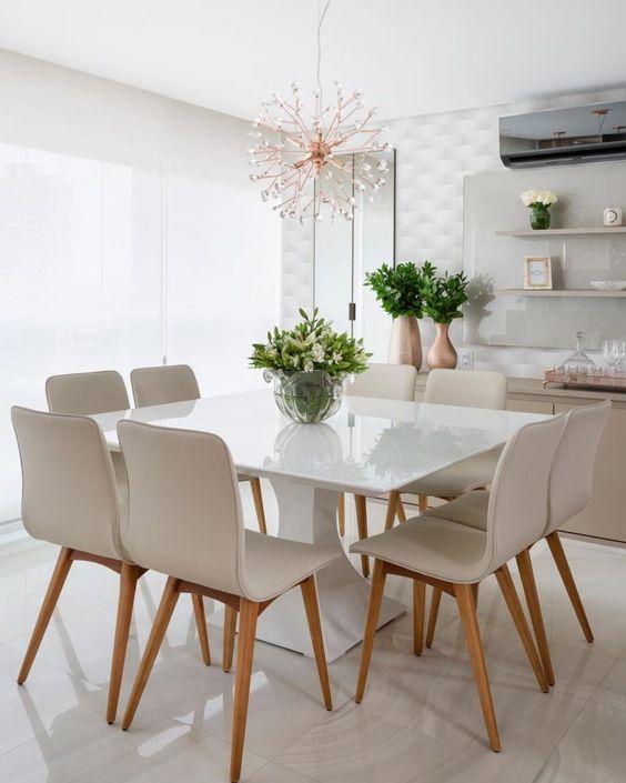 sala de jantar pequena branca com pendente moderno
