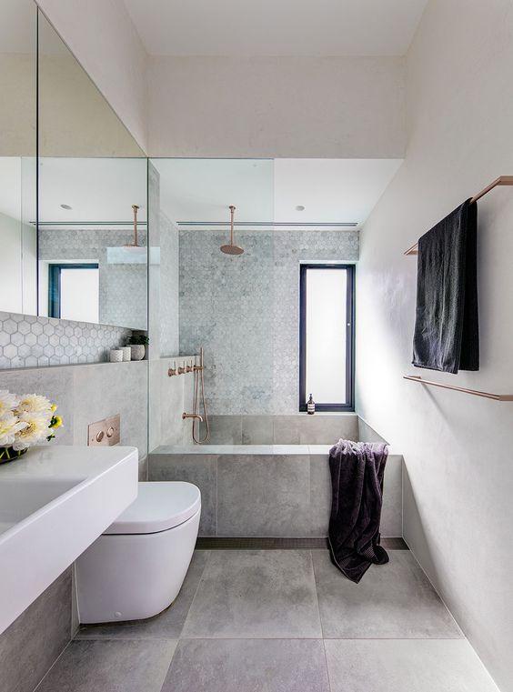 banheiro moderno com banheira de cimento queimado
