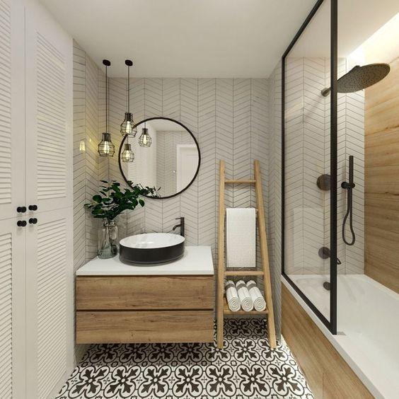 Decoração moderna com azulejo de geométrico, armário de madeira e piso decorado.