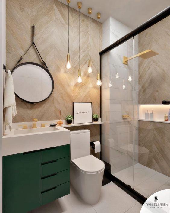 Decoração simples com armário verde e pendente suspenso moderno.