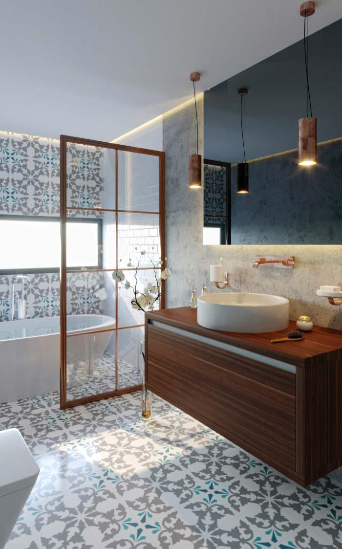 Banheiro feminino moderno com armário de madeira, banheira e azulejo colorido.