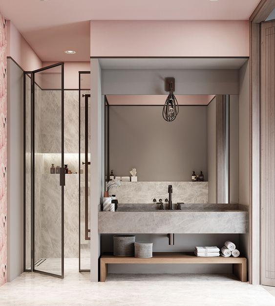 Banheiro feminino moderno com bancada de madeira.