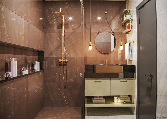 Decoração moderna com porcelanato, cuveiro dourado e espelho redondo.