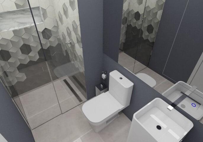 Banheiro pequeno azul escuro com azulejo geométrico preto.
