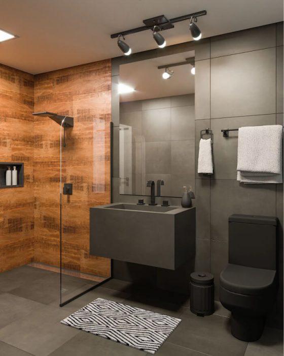 Decoração moderna com vaso e lavatório cinza.