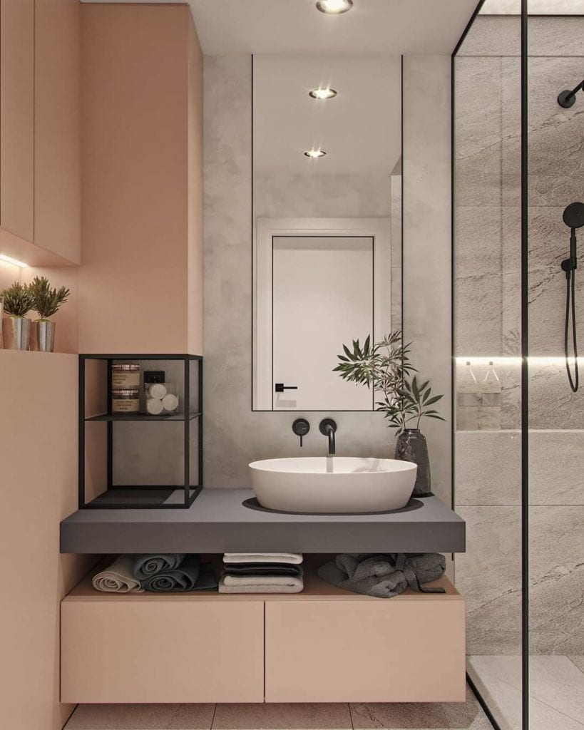 Decoração moderna com armário rosa e bancada cinza.