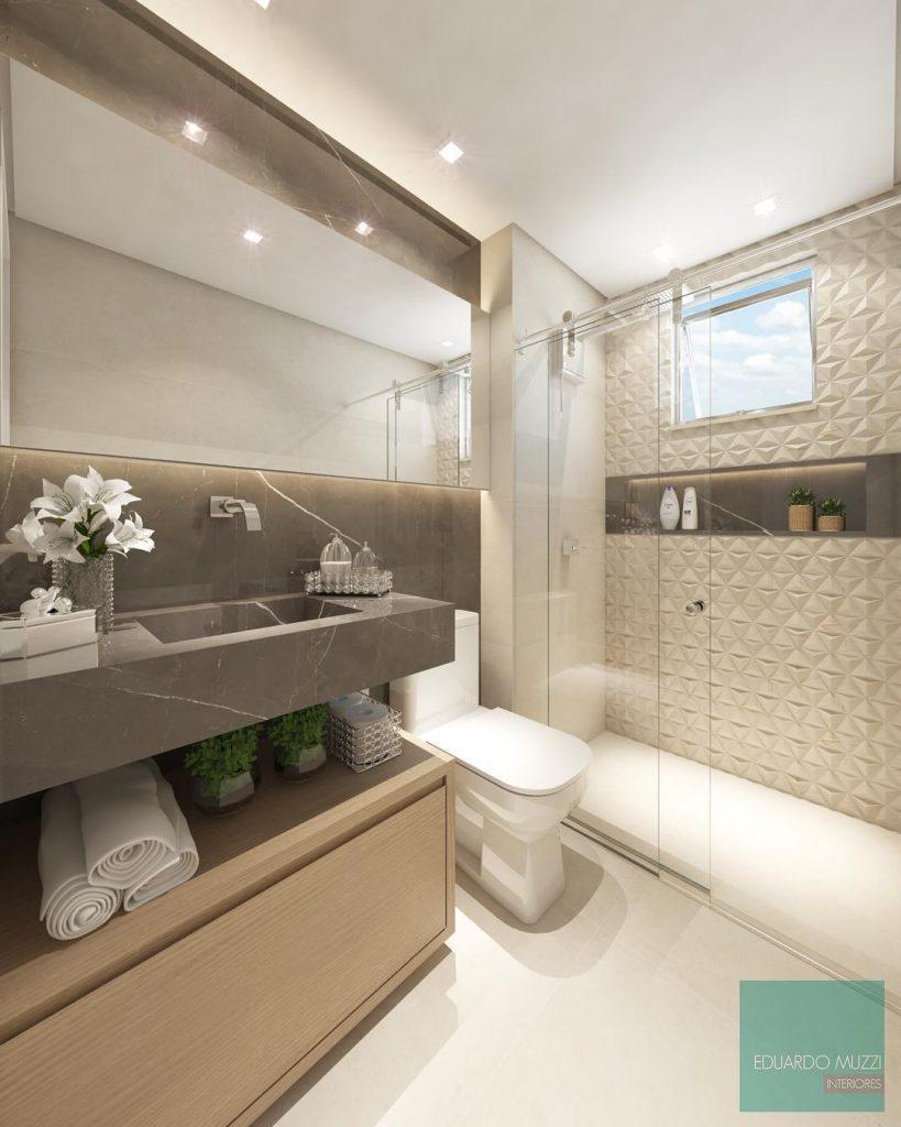 Decoração moderna com bancada de mármore, espelho iluminado e armário de madeira.