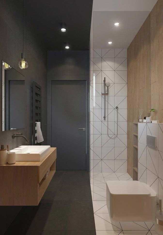 Decoração moderna com azulejo geométrico, acabamento de madeira e parede cinza.