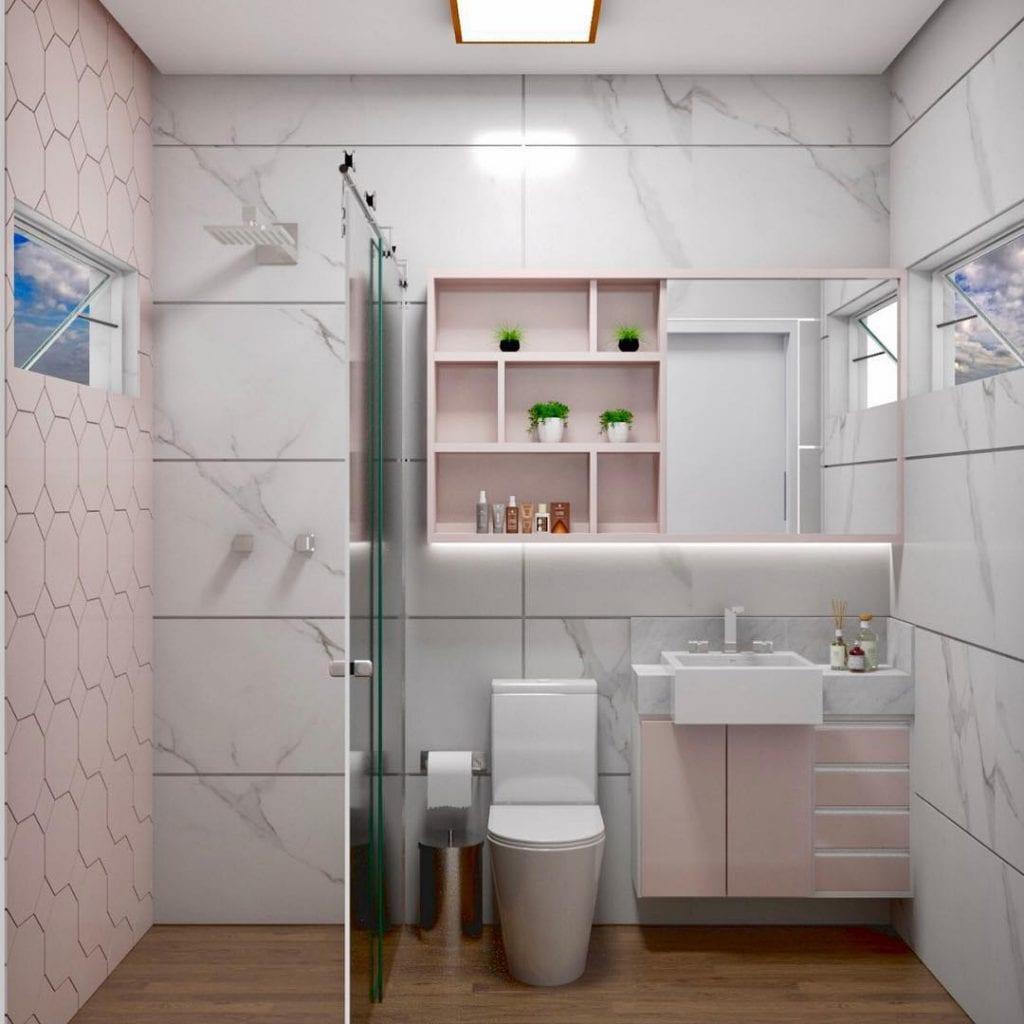 Decoração moderna com azulejo geométrico rosa, piso de madeira e louça de cerâmico com design moderno.