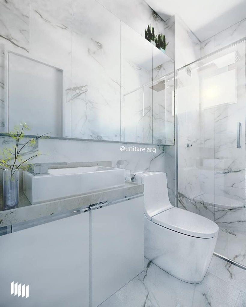 Banheiro pequeno decorado luxuoso  com mármore.