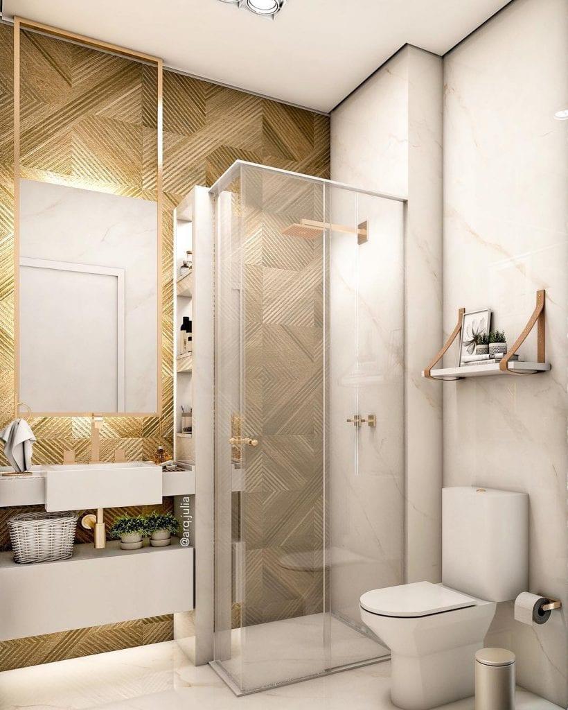 Banheiro pequeno decorado luxuoso com armário branco.