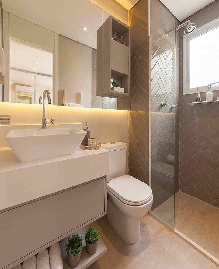 Banheiro simples com azulejo tijolinho marrom.