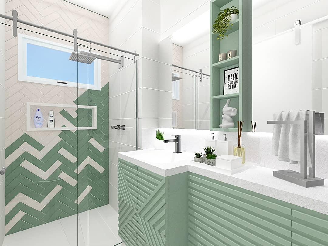 Banheiro simples colorido com armário verde menta.