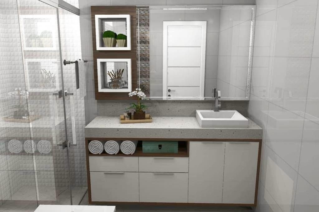 Decoração com cuba de apoio, bancada de granito e armário branco.