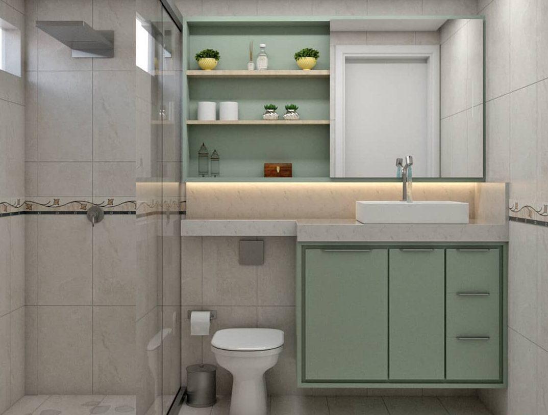 Banheiro simples com armário verde menta.