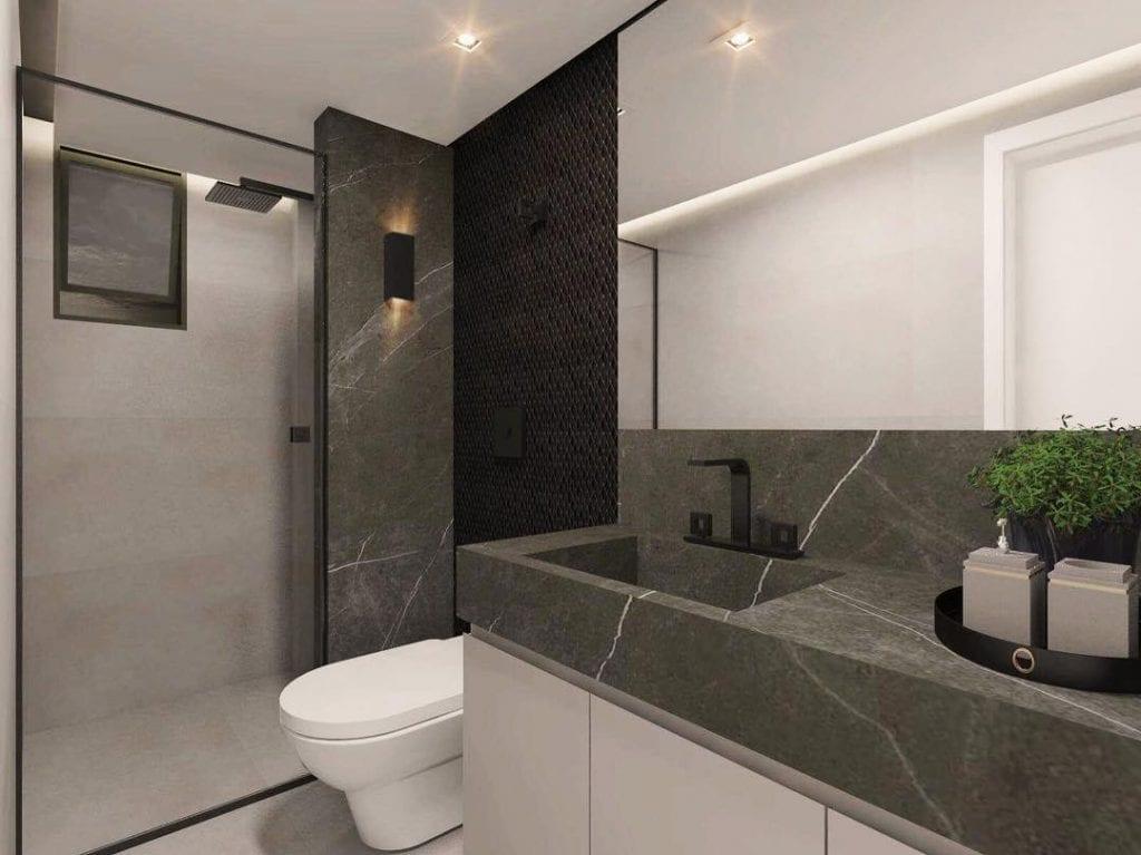 Banheiro simples peto e branco.
