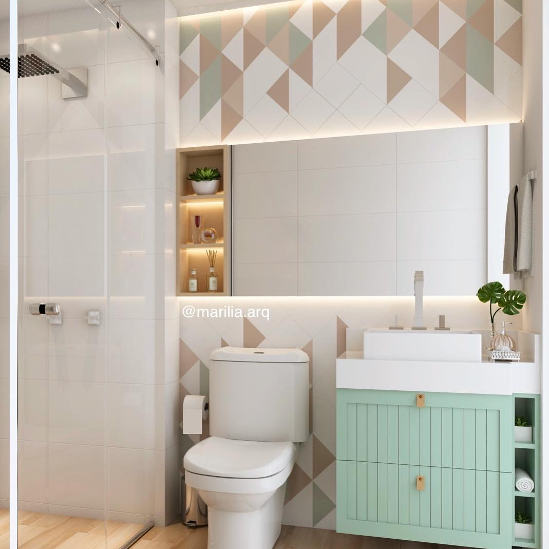 Banheiro simples com armário verde menta e azulejo decorado.