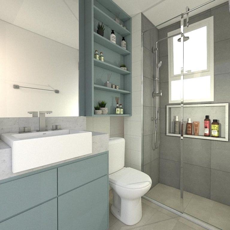 Banheiro simples com cerâmica cinza, cuba de semi encaixe e armário verde.