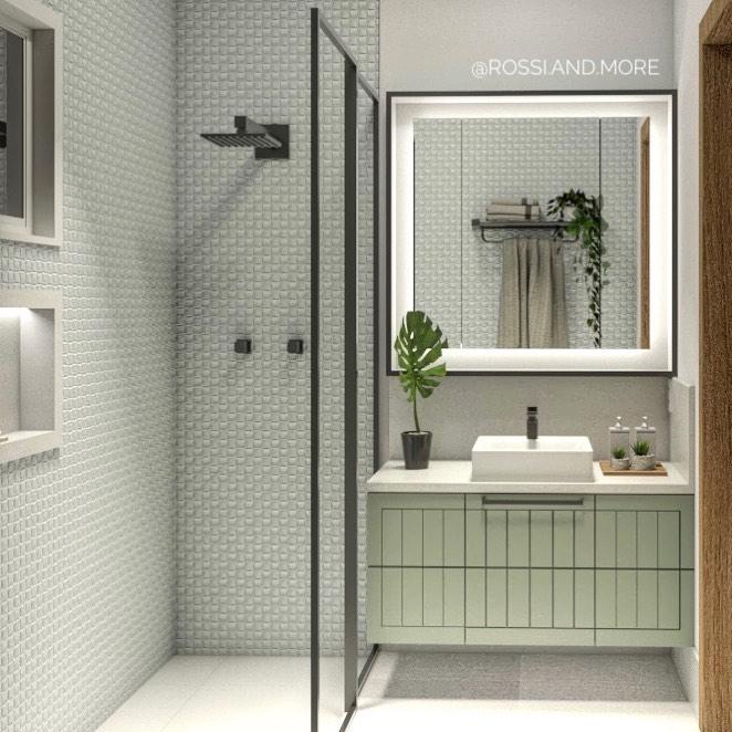 Banheiro simples com azulejo decorado, armário verde.