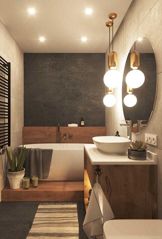 pendente de banheiro dourado e bancada de madeira