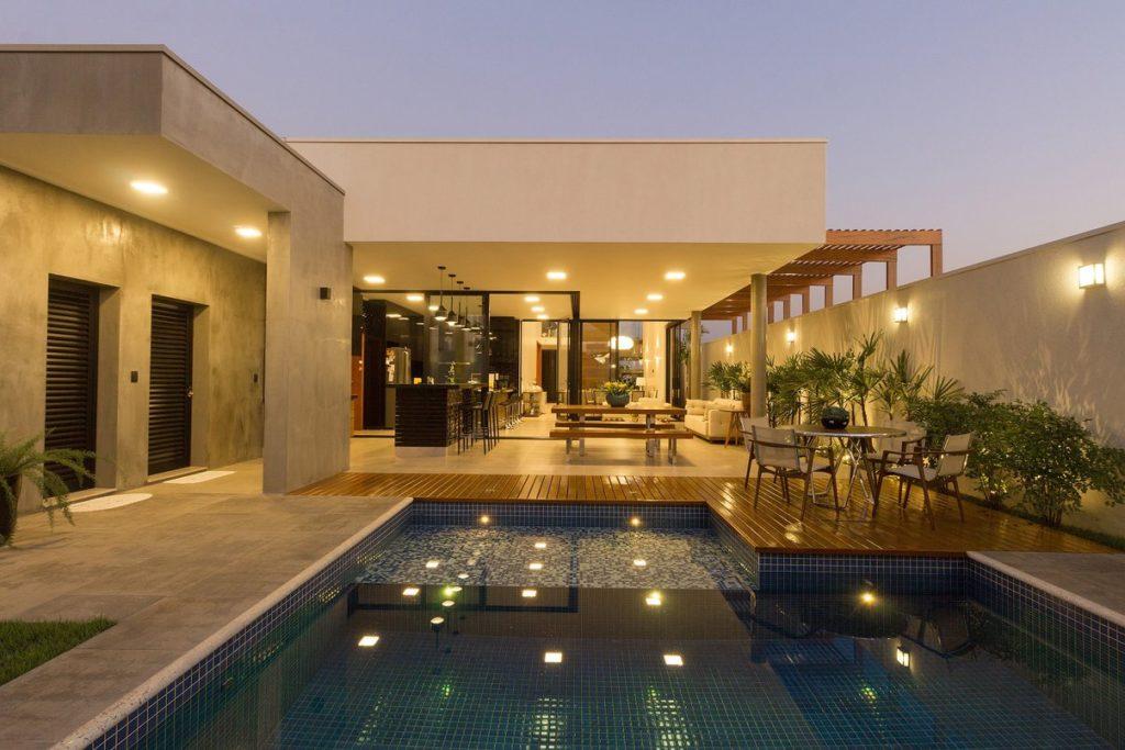 casa em l com piscina