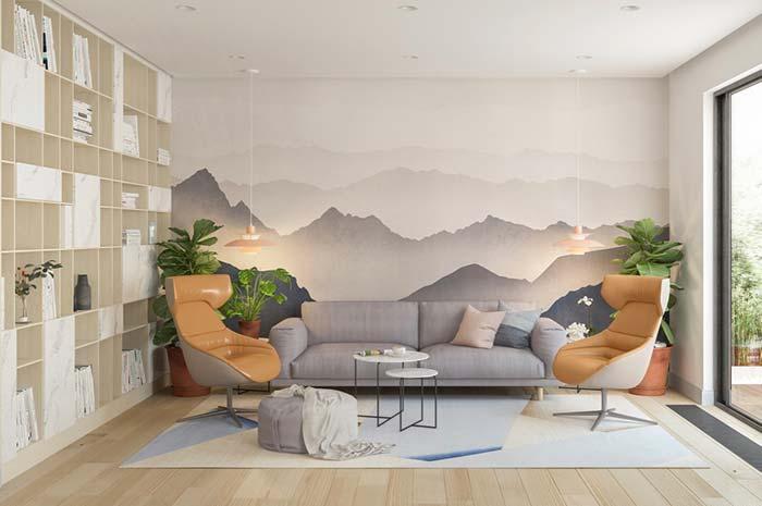 Como decorar uma sala moderna com sofá cinza, pintura na parede e pendentes suspensos.