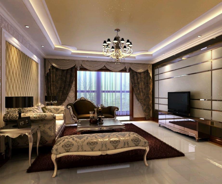 Como decorar uma sala luxuosa com sofás com design rococó e lustre tradicional.