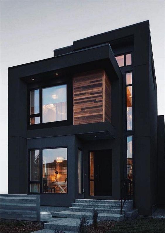 Cores de casas escuras combinam com revestimento de madeira.