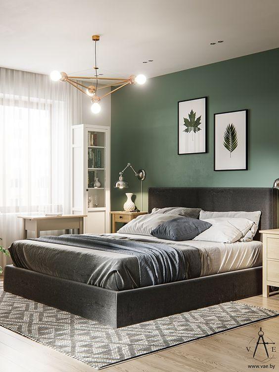 Quarto verde com quadros de folhas.