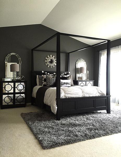 Quarto com uma parede preta e tapete cinza.