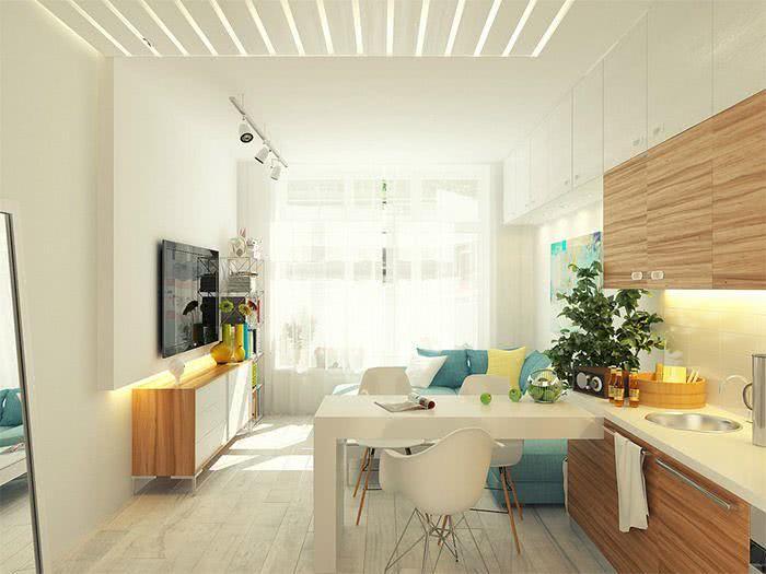Cozinha americana pequena com sala simples e minimalista.