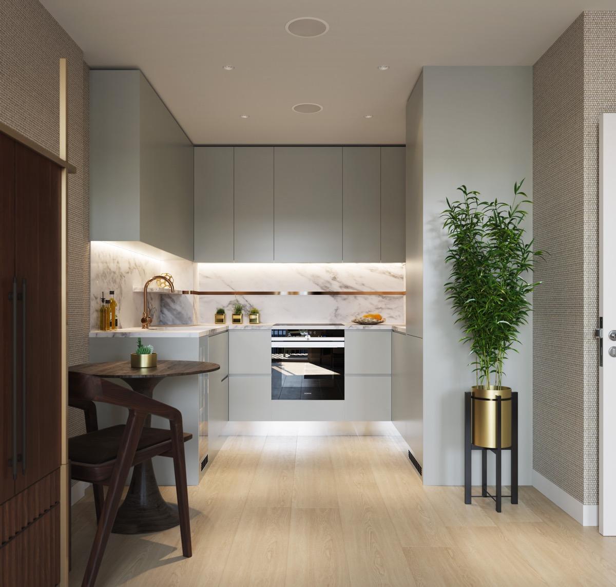 Cozinha em U planejada moderna com porcelanato.