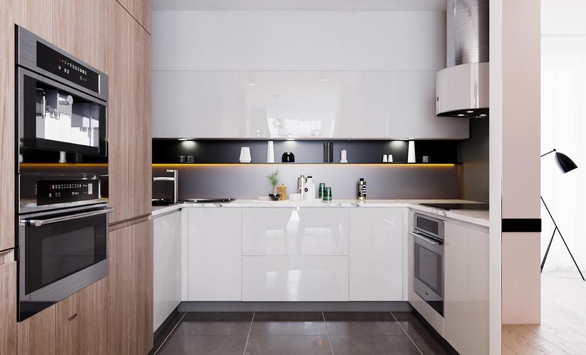 Cozinha em U moderna com fita de led.