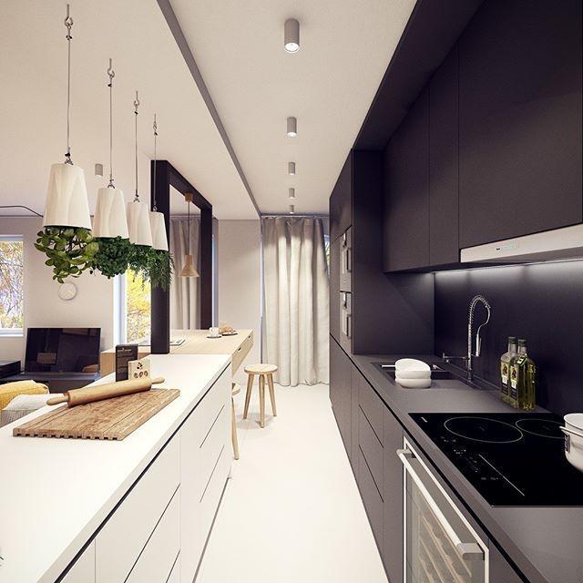 Cozinha pequena com decoração preta e branca.