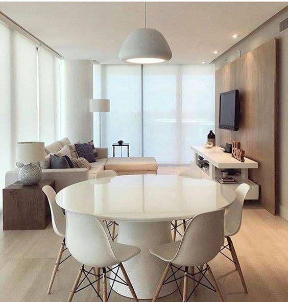 mesa redonda e cadeiras eames brancas