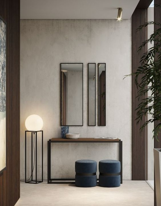 hall de entrada minimalista e moderno com espelhos