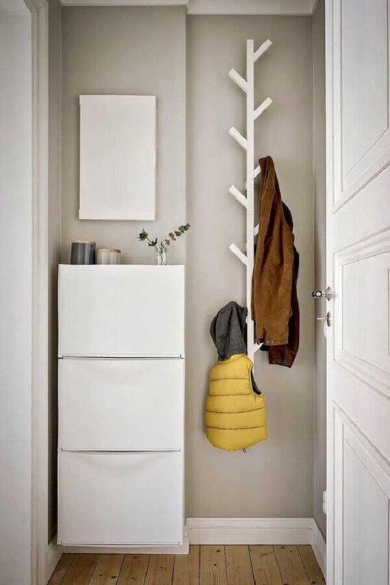 hall de entrada pequeno com mini armário