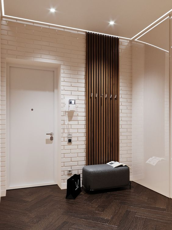 hall de entrada minimalista com parede de tijolinhos