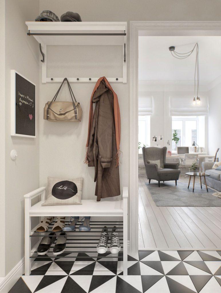 hall de entrada com sapateira e piso preto e branco